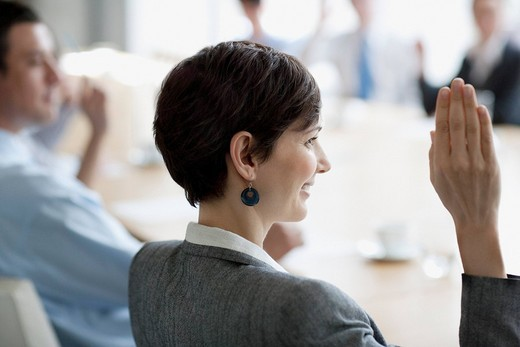 Stock Photo: 1775R-20229 Business people raising hands in meeting in conference room