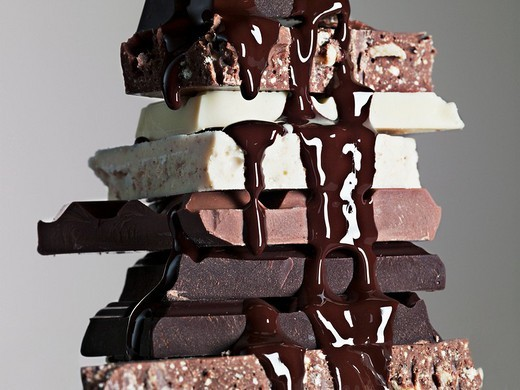 Stock Photo: 1775R-20468 Close up of chocolate syrup dripping over stack of chocolate bars