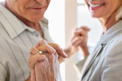 Stock Photo: 1775R-20852 Close up of senior couple holding hands