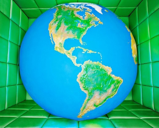 Globe in padded room : Stock Photo