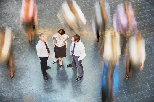 Stock Photo: 1775R-21244 People rushing past business people talking