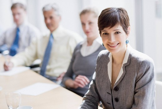 Stock Photo: 1775R-21257 Smiling businesswoman in conference room