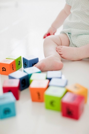 Stock Photo: 1775R-21359 Baby on floor with wood blocks