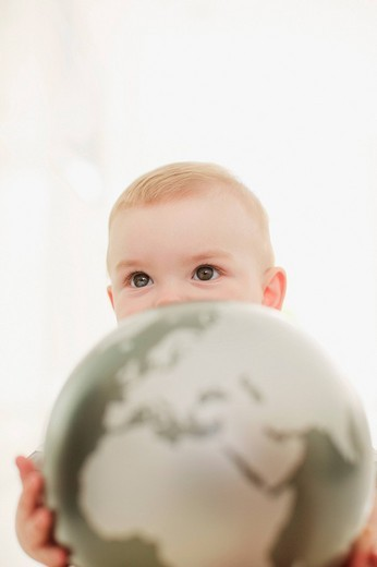 Close up of baby holding globe : Stock Photo
