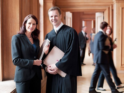 Stock Photo: 1775R-21413 Smiling judge and lawyer in corridor