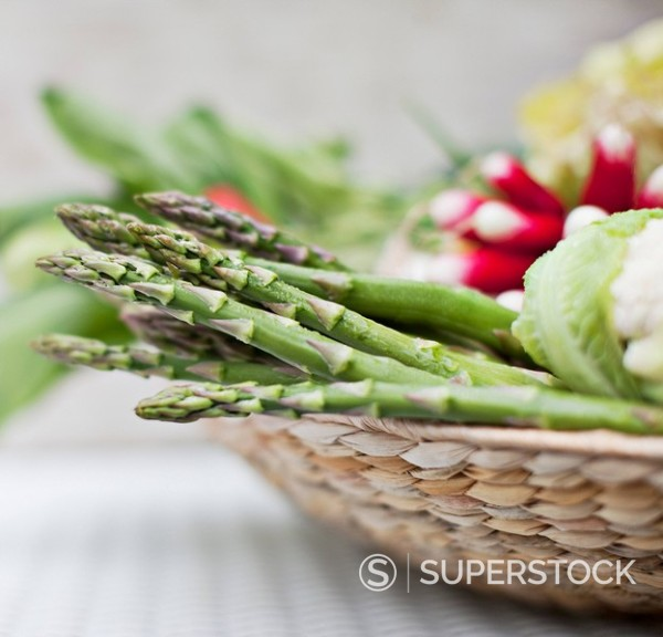 Asparagus in basket of vegetables : Stock Photo
