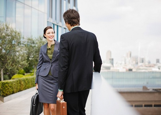 Smiling business people outside building : Stock Photo