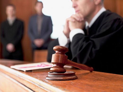 Stock Photo: 1775R-21558 Judge and gavel in courtroom