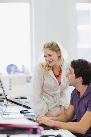 Business people working at laptop in office : Stock Photo
