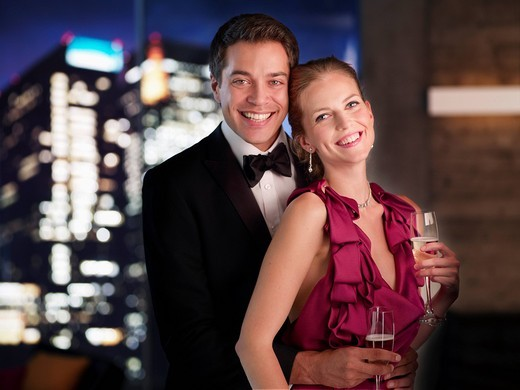 Stock Photo: 1775R-21909 Elegant couple drinking Champagne at night