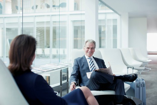 Business people waiting in airport : Stock Photo