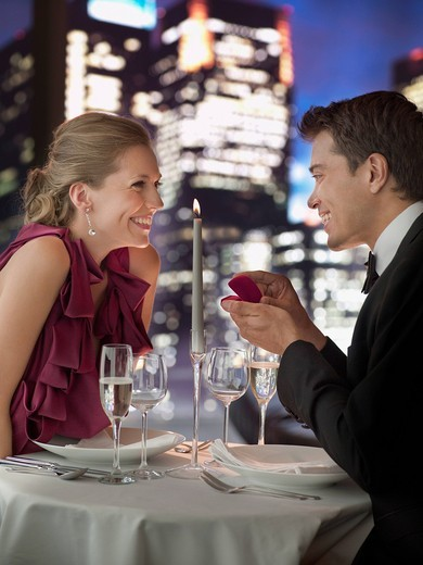 Stock Photo: 1775R-22539 Man in tuxedo proposing engagement to girlfriend