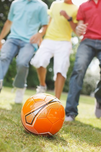 Teenage boys playing soccer together : Stock Photo