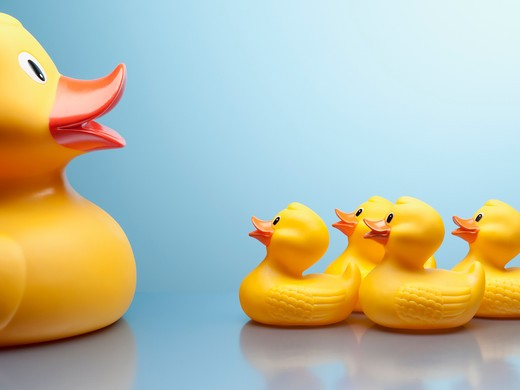 Mother rubber duck and several rubber ducklings : Stock Photo