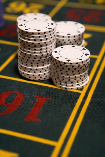 Close up of gambling chips on gaming table : Stock Photo