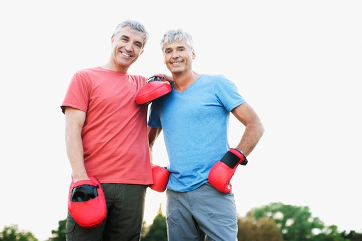 Boxer standing with his sparring partner : Stock Photo