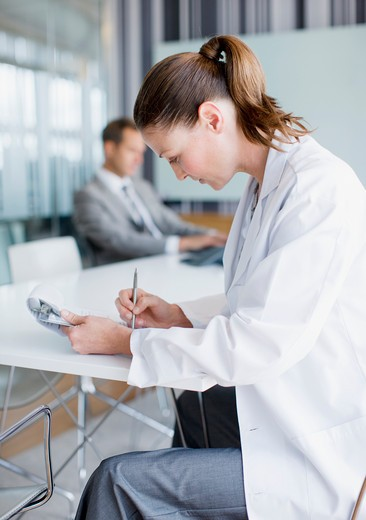 Scientist working in conference room : Stock Photo