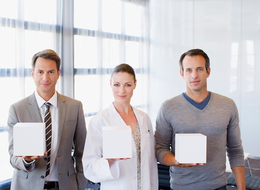 Business people and scientist holding cubes : Stock Photo