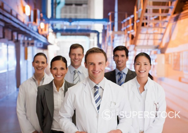 Stock Photo: 1775R-23536 Scientists and business people standing together in factory