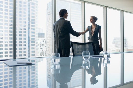 Stock Photo: 1775R-23971 Business people shaking hands in conference room