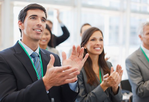 Business people clapping at seminar in office : Stock Photo
