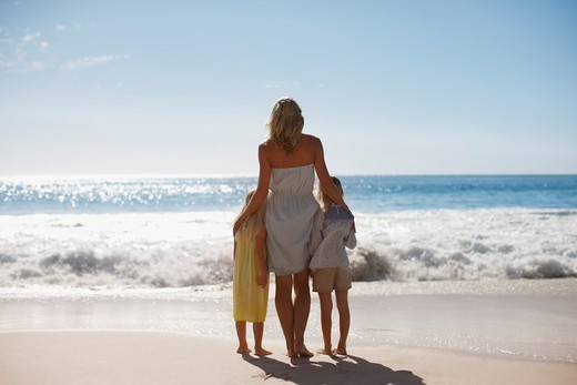 Stock Photo: 1775R-24628 Mother and daughters on beach looking at ocean