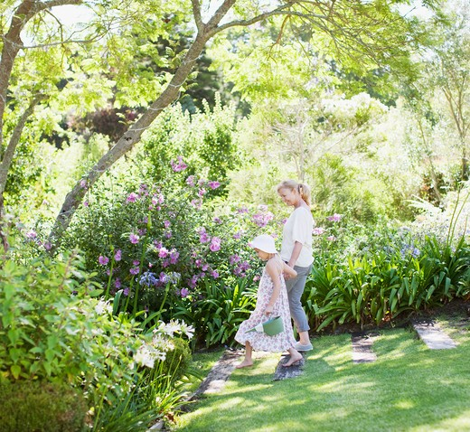 Grandmother and granddaughter in garden : Stock Photo