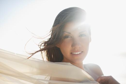 Stock Photo: 1775R-24928 Sun shining on woman
