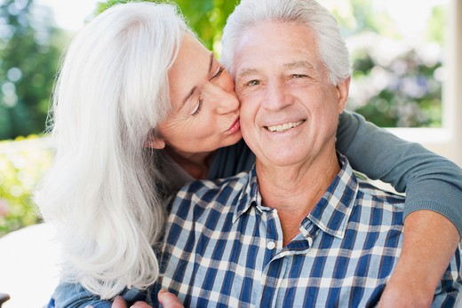Stock Photo: 1775R-25178 Senior woman kissing man's cheek