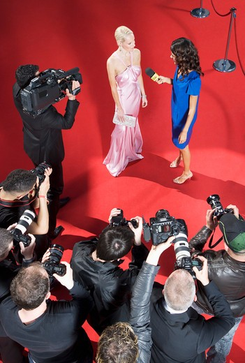 Stock Photo: 1775R-25424 Celebrity talking to reporter on red carpet