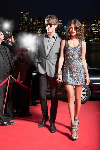 Celebrity walking on red carpet : Stock Photo