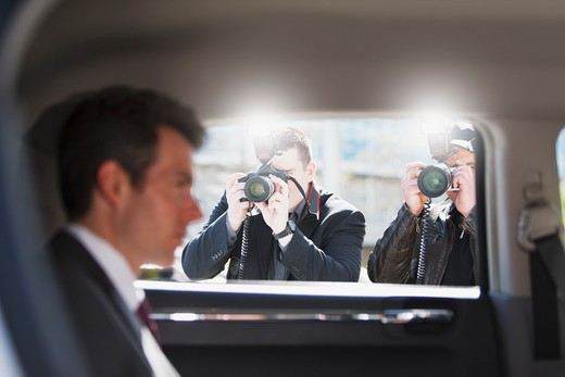 Stock Photo: 1775R-25514 Paparazzi taking pictures of politician in car
