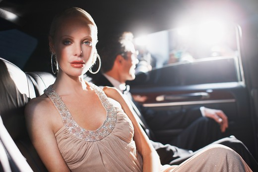 Stock Photo: 1775R-25522 Celebrity sitting in backseat of car