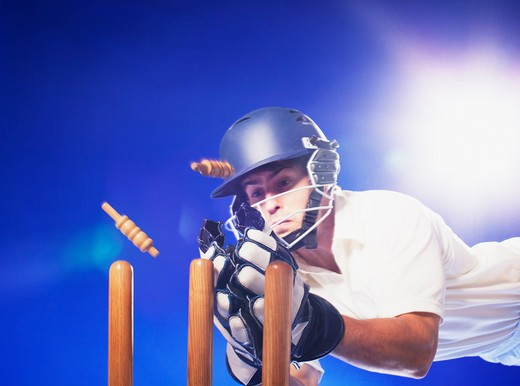Stock Photo: 1775R-25809 Cricket player reaching for bats