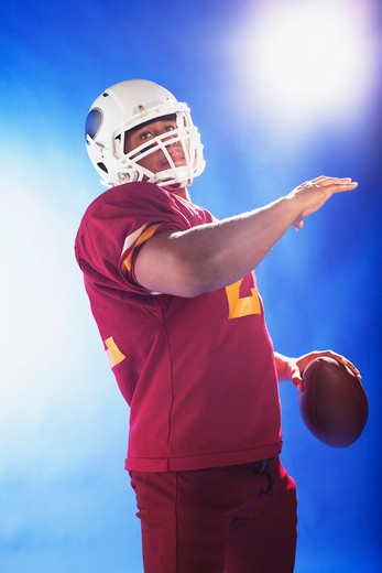 Football player holding ball : Stock Photo