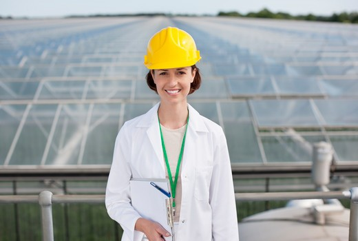 Scientist standing on roof of building : Stock Photo