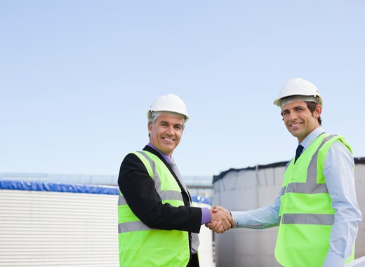 Businessmen shaking hands outdoors : Stock Photo