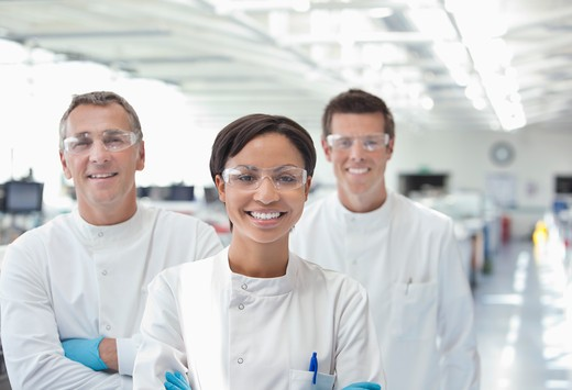 Scientists smiling together in lab : Stock Photo
