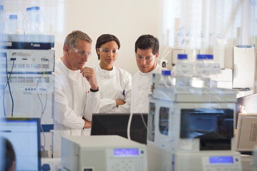Scientists using equipment in lab : Stock Photo