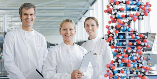 Scientists with molecular model in lab : Stock Photo