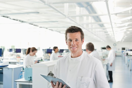 Stock Photo: 1775R-26098 Scientist using clipboard in lab