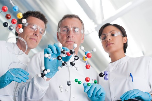 Scientists making molecular model in lab : Stock Photo