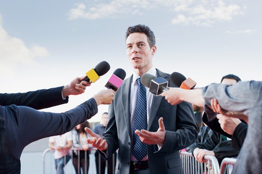 Stock Photo: 1775R-26187 Politician talking into reporters´ microphones