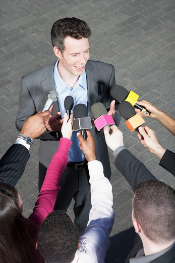 Stock Photo: 1775R-26213 Politician talking into reporters´ microphones