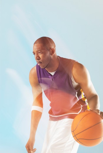 Stock Photo: 1775R-26311 Blurred view of basketball player dribbling