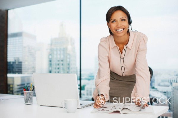 Stock Photo: 1775R-26739 Businesswoman working at desk