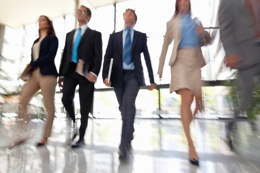 Business people walking together : Stock Photo