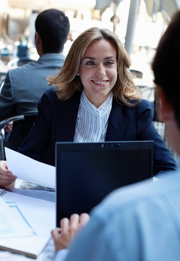 Business people working together in sidewalk cafe : Stock Photo