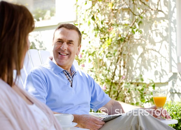 Stock Photo: 1775R-27492 Couple sitting in backyard together