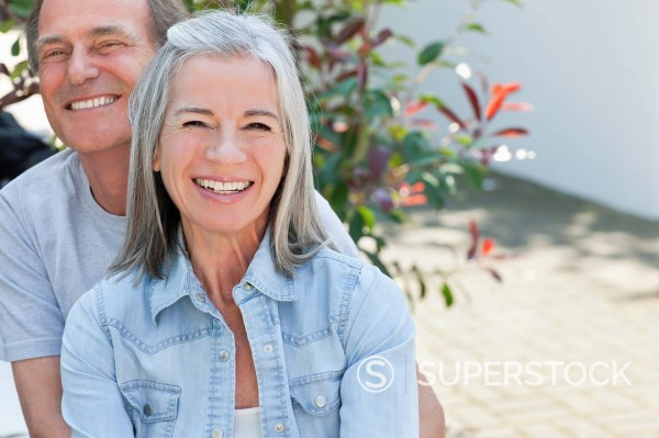 Portrait of smiling couple outdoors : Stock Photo